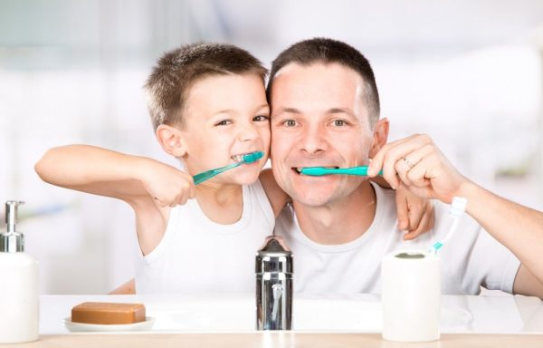 father-and-son-brushing-teeth-together-1000x640